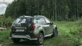 french street : Gomel, Belarus - Junly 5, 2018: Renault Duster SUV in summer forest landscape. Duster produced jointly by French manufacturer Renault. Time Lapse, Time-lapse Stock Footage