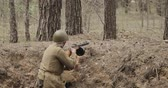 urss : Russian Soviet Infantry Soldier Of World War II Reloading Sub-machine Gun In Forest Trench. Soldier Attacking Enemy In Forest During Historical Reenactment