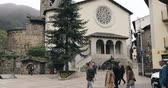 tőke : Andorra La Vella, Andorra - May 15, 2018: People Walking On Prince Benlloch Square Near Famous Church Of Saint Esteve. Esglesia De Sant Esteve Located On Placa Del Princep Benlloch. Cultural Heritage