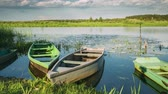 Lake Or River And Old Wooden Rowing Fishing Boats In Beautiful Summer Sunny Evening