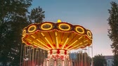 Brightly Illuminated Rotating High Speed Carousel Merry-Go-Round. Summer Evening Night In City Amusement Park Wideo