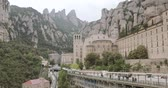 ibadet : Catalonia, Spain. Santa Maria De Montserrat. Benedictine Abbey In Mountain Of Montserrat, In Monistrol De Montserrat, In Catalonia, Spain Stok Video