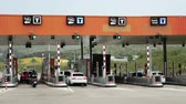 оплаченный : Cars Passing Through The Automatic Point Of Payment On A Toll Road. Point Of Toll Highway, Toll Station. Highway Toll Plaza Or Turnpike Or Charging Point, Entrance On Motorway