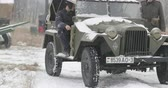 reencenação : Gomel, Belarus - November 25, 2018: Re-enactors Dressed As Russian Soldiers Of World War II drives Soviet WWII Army Truck GAZ-67 Car In Winter Forest. WWII Equipment Of Red Army Vídeos