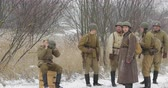 askerler : Gomel, Belarus - November 25, 2018: Re-enactors Dressed As Russian Soviet Soldiers Of World War II In Winter Forest Stok Video