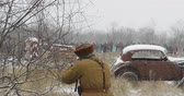 askerler : Re-enactor Dressed As Red Army Russian Soldier Partisan Guerrilla Of World War II Holding Rifle And Running On Battlefield Stok Video
