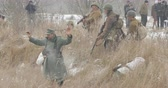 gyalogság : Gomel, Belarus - November 25, 2018: Re-enactor Dressed As Russian Soldiers Of World War II Performing Mopping-up Operation. German Wehrmacht Soldiers Come Out Of Ambush And Surrender To Captivity Stock mozgókép