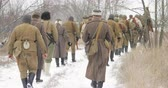 urss : Re-enactors Dressed As Russian Soviet Soldiers Of World War II Marching Along Forest Road At Winter Season