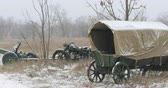 motosiklet : Abandoned Russian Soviet Equipment And Vehicles Of World War II. Russian Soviet 45mm Anti-tank Gun, Old Tricar Three-wheeled Motorcycle And Peasant Cart In Winter Snowy Day Stok Video