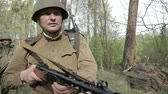 gyalogság : Gomel, Belarus - April 30, 2018: Re-enactor Dressed As Russian Soviet Infantry Red Army Soldier Of World War II Walking With Weapon In Spring Forest