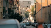 flavian : Rome, Italy. Colosseum Also Known As Flavian Amphitheatre. Traffic In Rome Near Famous World Landmark