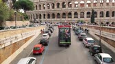 Rome, Italy - October 21, 2018: Colosseum. Red Hop On Hop Off Touristic Bus For Sightseeing In Street Near Flavian Amphitheatre. Famous World UNESCO Landmark. City Sightseeing Tour. slow motion.