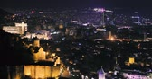 kafkaslar : Tbilisi, Georgia. Top View Of Narikala Fortress Amd Modern Skyscraper In Autumn Night. Georgian Capital Skyline Cityscape Stok Video