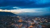 spravedlnost : Tbilisi, Georgia. Top View Of Famous Landmarks In Night Illuminations. Georgian Capital Skyline Cityscape. City During Sunset And Night Illuminations. Day To Night Transition