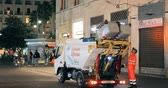 özel : Naples, Italy - October 18, 2018: Automated Garbage Truck Working In Night Street. Dustcart, Trash Truck, Rubbish Truck, Junk Truck, Dumpster Specially Designed To Collect Municipal Waste