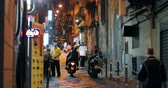 Naples, Italy - October 18, 2018: Night Traffic With Scooters And Bikes In Narrow Via Giuseppe Simonelli Street 무비클립