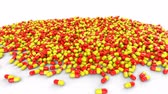 suplemento : Red-yellow pills capsules on a white background abstract concept. Animation with alpha channel