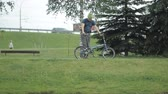 grizzled : Man on bicycle riding to the park with loptop