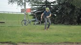 grizzled : Man on bicycle and laptop riding from the park