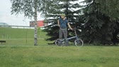 grizzled : Man on bicycle riding to the park with tablet