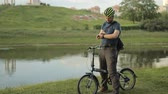 grizzled : Man on folding bicycle with smartwatch Stock Footage