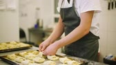 flour : Cook preparing buns with cheese. Stock Footage