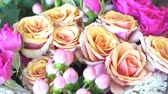 ıslak : Spraying of beautiful bouquet of bright pink and beige roses.