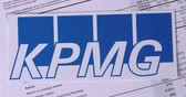 balança : SARANSK, RUSSIA - NOVEMBER 05, 2017: KPMG logo with financial reports.