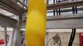 tubular : Extrusion of yellow plastic in a factory Stock Footage
