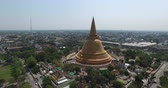 golden : Aerial scene  of Old  big Thai buddhist pagoda and city at  Nakhon Pathom Province , Thailand Stock Footage