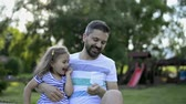 дочь : Father with his little daughter outside in park