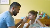 wirus : Little girl with chickenpox, eating medicine on spoon