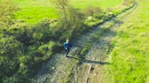 curva : Young fit athlete running in green sunny autumn nature.