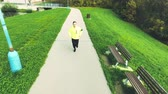 casa de campo : Young athlete running around the lake, colorful autumn nature
