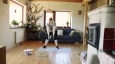 consciente : Attractive overweight woman at home working out with medicine ball.