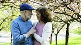 blooming : Beautiful senior couple in love outside in spring nature.