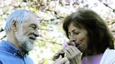 подарок : Beautiful senior couple in love outside in spring nature.