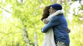 marido : Beautiful senior couple in love outside in spring nature kissing.