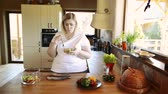kitchen counter : Overweight woman at home eating vegetable salad in the kitchen. Stock Footage