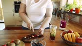 kiwi : Unrecognizable overweight woman preparing healthy smoothie.