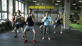 fisiculturismo : Young people in crossfit gym doing squats with kettlebells