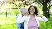 cardigã : Beautiful senior couple in love outside in spring nature.