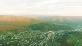 casa de campo : Aerial view of small town with hills, Slovakia. Autumn nature. Stock Footage