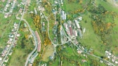 prato : Aerial view of small town with hills, Slovakia. Autumn nature. Stock Footage