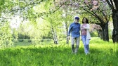 florescente : Beautiful senior couple in love outside in spring nature.