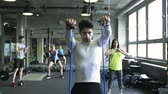 resistência : Young people in crossfit gym working out with various equipment.