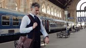 check the time : Mature businessman on a train station.