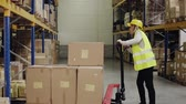 cardboard : Female warehouse worker with hand forklift truck.
