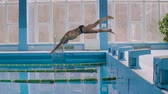 mergulhador : Senior man jumping in the swimming pool.
