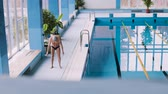 nadador : Senior man stretching by the indoor swimming pool.